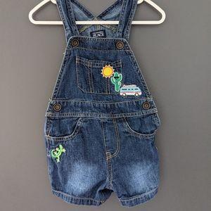 Denim blue jean shortalls with desert embroidery